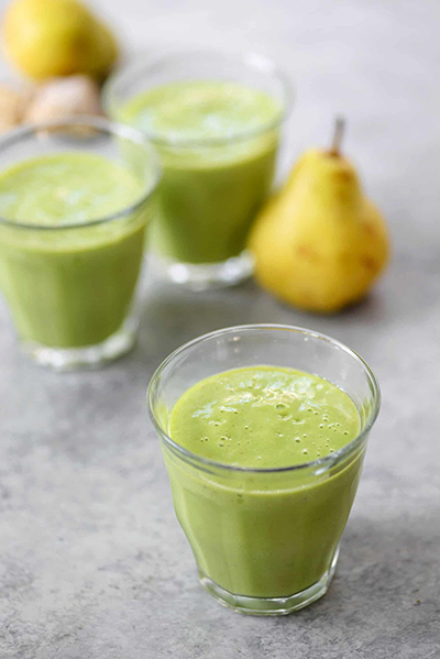 A refreshing green smoothie made from pear, ginger, and spinach
