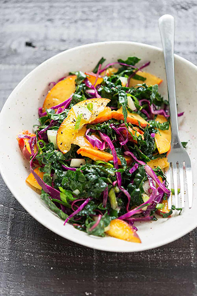 Salad of wilted kale, peaches, and red cabbage