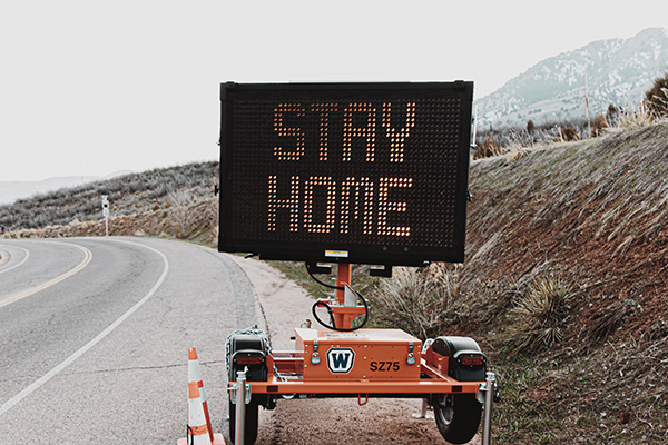 "Construction traffic sign displaying ""Stay Home"""