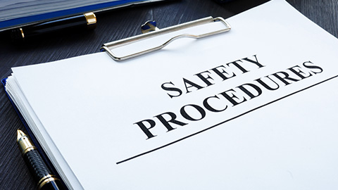 "A report titled ""Safety Procedures"" on a clipboard"