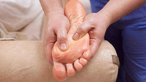 Foot massage being given to the sole of a foot