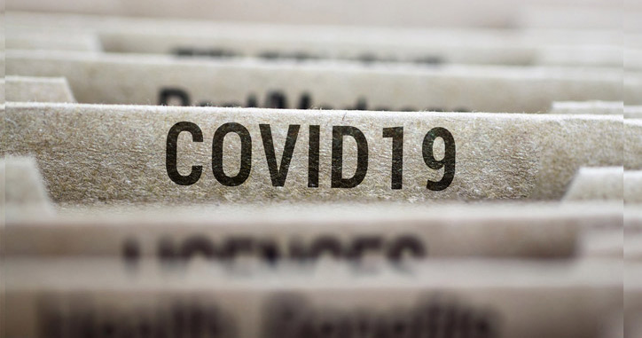 Financial folders with one folder boldy labeled Covid-19